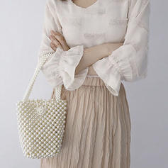 Pearl Style Clutches/Wallets & Wristlets