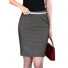 poliéster Color sólido Sobre la rodilla Faldas Lápiz