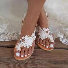Femmes PU Talon plat Sandales Chaussures plates Anneau d'orteil avec Une fleur Couleur unie chaussures