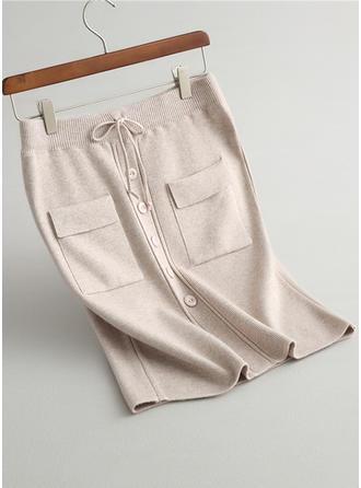 Tejido de punto Color sólido Hasta la rodilla Faldas A-Line