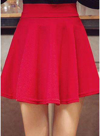 Polyester Couleur unie Au-dessus du genou Jupes trapèze