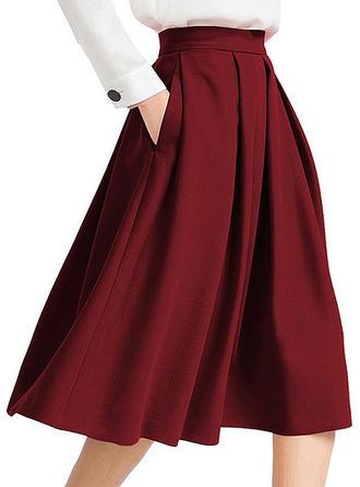 Polyester Couleur unie longueur au genou Jupes évasées Jupes trapèze